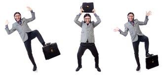 Νέος επιχειρηματίας χαρτοφύλακα εκμετάλλευσης κοστουμιών που απομονώνεται στον γκρίζο στο whi Στοκ φωτογραφία με δικαίωμα ελεύθερης χρήσης