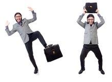 Νέος επιχειρηματίας χαρτοφύλακα εκμετάλλευσης κοστουμιών που απομονώνεται στον γκρίζο στο whi Στοκ Φωτογραφίες