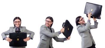 Νέος επιχειρηματίας χαρτοφύλακα εκμετάλλευσης κοστουμιών που απομονώνεται στον γκρίζο στο whi Στοκ Εικόνες