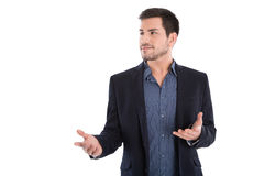 Νέος ελκυστικός επιχειρηματίας Quizzically με τα ανοικτά χέρια. Στοκ Φωτογραφίες