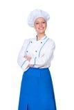 Νέος θηλυκός μάγειρας που εξετάζει τη φωτογραφική μηχανή Στοκ φωτογραφία με δικαίωμα ελεύθερης χρήσης