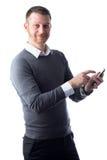 Νέος σπουδαστής που χρησιμοποιεί το smartphone Στοκ Εικόνες