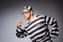 Νέος φυλακισμένος ενάντια σε γκρίζο Στοκ φωτογραφίες με δικαίωμα ελεύθερης χρήσης