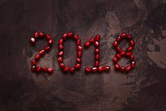 Νέο έτος 2018 τοπ άποψη σπόρων ροδιών κειμένων Στοκ φωτογραφία με δικαίωμα ελεύθερης χρήσης