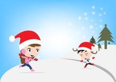 Νέο έτος Χαρούμενα Χριστούγεννας με το χαμογελώντας αγόρι και το κορίτσι μέσα, μπλε υπόβαθρο θέματος χειμερινών διακοπών Στοκ φωτογραφία με δικαίωμα ελεύθερης χρήσης