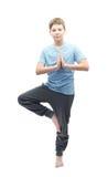 Νέο αγόρι που κάνει τη γιόγκα Στοκ φωτογραφία με δικαίωμα ελεύθερης χρήσης