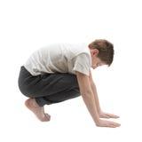 Νέο αγόρι που τεντώνει ή που κάνει τη γιόγκα Στοκ εικόνα με δικαίωμα ελεύθερης χρήσης
