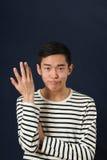 Νέο ασιατικό ατόμων Displeased με ένα χέρι Στοκ Φωτογραφίες