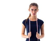 Νέο εκατοστόμετρο εκμετάλλευσης γυναικών γύρω από το λαιμό της Στοκ Φωτογραφία