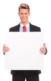 Νέο επιχειρησιακό άτομο με το κενό χαρτόνι Στοκ φωτογραφία με δικαίωμα ελεύθερης χρήσης