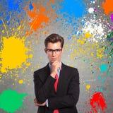 Άτομο με τους παφλασμούς χρώματος γύρω από τον Στοκ Εικόνες