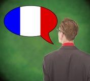 Νέο επιχειρησιακό άτομο που μιλά τα γαλλικά στο σχολικό πίνακα Στοκ Εικόνες