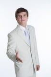Νέο επιχειρησιακό άτομο που φορά το άσπρο κοστούμι στοκ φωτογραφία