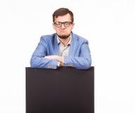 Νέο διαγώνιο άτομο που παρουσιάζει παρουσίαση, που δείχνει στην αφίσσα Στοκ Εικόνα