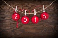 2015 νέο κείμενο έτους στα μπιχλιμπίδια Χριστουγέννων Στοκ εικόνα με δικαίωμα ελεύθερης χρήσης