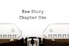 Νέο κεφάλαιο ένα ιστορίας γραφομηχανή στοκ εικόνα