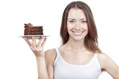 Νέο κομμάτι εκμετάλλευσης γυναικών του κέικ σοκολάτας Στοκ Φωτογραφίες