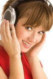 Νέο κορίτσι με τα ακουστικά  κινηματογράφηση σε πρώτο πλάνο Στοκ Εικόνες