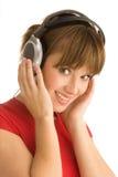 Νέο κορίτσι με τα ακουστικά Στοκ Φωτογραφία
