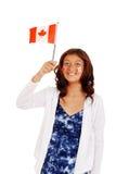 Νέο κορίτσι με τη σημαία και τις δερματοστιξίες του Καναδά Στοκ Φωτογραφίες