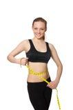 Νέο κορίτσι με το εκατοστόμετρο να κάνει δίαιτα στην έννοια Στοκ Εικόνες