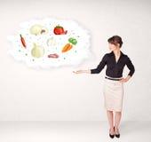 Νέο κορίτσι που παρουσιάζει το θρεπτικό σύννεφο με τα λαχανικά Στοκ εικόνες με δικαίωμα ελεύθερης χρήσης