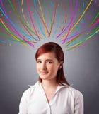 Νέο κορίτσι που σκέφτεται με τις ζωηρόχρωμες αφηρημένες γραμμές εναέριες Στοκ φωτογραφία με δικαίωμα ελεύθερης χρήσης