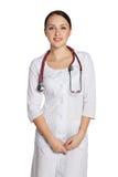 Νέο κορίτσι σε ένα ιατρικό παλτό εργαστηρίων Στοκ εικόνα με δικαίωμα ελεύθερης χρήσης