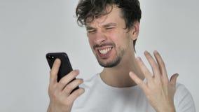 Νέο περιστασιακό άτομο που αντιδρά στην απώλεια χρησιμοποιώντας Smartphone απόθεμα βίντεο