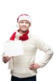 Νέο περιστασιακό άτομο στα hoding Χριστούγεννα καπέλων santa Στοκ φωτογραφίες με δικαίωμα ελεύθερης χρήσης