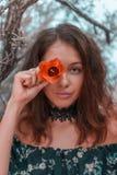 Νέο πορτοκαλί λουλούδι εκμετάλλευσης γυναικών στο μάτι της Στοκ Φωτογραφίες