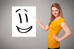 Νέο σχέδιο προσώπου smiley εκμετάλλευσης γυναικών Στοκ Εικόνες