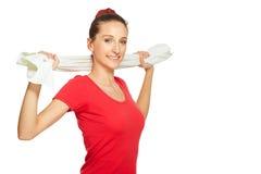 Νέο τέντωμα γυναικών ικανότητας με την πετσέτα στοκ φωτογραφίες