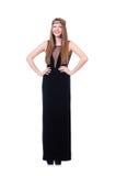 Νέο redhead gril στο μαύρο μακρύ φόρεμα που απομονώνεται επάνω στοκ φωτογραφία