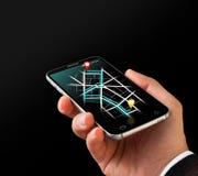 Ναυσιπλοΐα ΠΣΤ κινηματογραφήσεων σε πρώτο πλάνο σε Smartphone Χρησιμοποίηση της κινητής έννοιας τηλεφωνικών συσκευών ναυσιπλοΐας Στοκ φωτογραφία με δικαίωμα ελεύθερης χρήσης