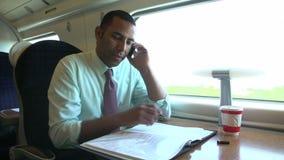 Να ανταλάξει επιχειρηματιών για να εργαστεί στο τραίνο που χρησιμοποιεί το κινητό τηλέφωνο φιλμ μικρού μήκους