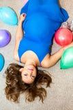 να βρεθεί πατωμάτων έγκυος γυναίκα Στοκ φωτογραφία με δικαίωμα ελεύθερης χρήσης