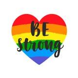 Να είστε ισχυρό σύνθημα Εμπνευσμένη ομοφυλοφιλική αφίσα υπερηφάνειας με τη σημαία φάσματος ουράνιων τόξων watercolor, εγγραφή βου απεικόνιση αποθεμάτων
