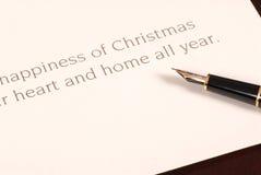 να είστε πέννα πηγών Χριστουγέννων καρτών που υπογράφεται στην αναμονή Στοκ Εικόνες
