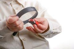 Να ενισχύσει - γυαλί και αυτοκίνητο υπό εξέταση Στοκ φωτογραφία με δικαίωμα ελεύθερης χρήσης