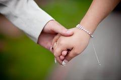 να διατηρήσει τη συνοχή χεριών Στοκ Φωτογραφίες