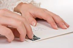 να κολλήσει γραμματοσήμ&o Στοκ Εικόνες