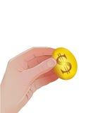Να μαζεψει με το χέρι επάνω το χρυσό αυγό Απεικόνιση αποθεμάτων