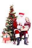 Να πάρει το δώρο από Άγιο Βασίλη στοκ εικόνες