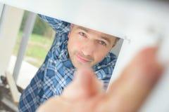 Να τοποθετήσει ατόμων άποψης καθρέφτης Στοκ Φωτογραφίες