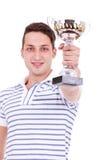 Νεαρός άνδρας που κερδίζει το πρώτο τρόπαιο θέσεων Στοκ εικόνα με δικαίωμα ελεύθερης χρήσης