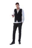 Νεαρός άνδρας που χρησιμοποιεί το κινητό τηλέφωνο Στοκ Εικόνα