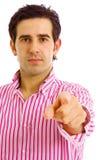 Νεαρός άνδρας σε ένα κοστούμι που δείχνει με το δάχτυλό του Στοκ φωτογραφία με δικαίωμα ελεύθερης χρήσης