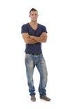Νεαρός άνδρας στα τζιν και την μπλούζα Στοκ Φωτογραφία