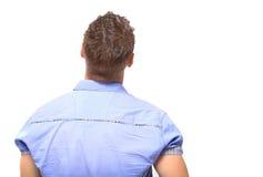 Νεαρός άνδρας από την πλάτη - που εξετάζει κάτι πέρα από μια άσπρη πλάτη Στοκ εικόνες με δικαίωμα ελεύθερης χρήσης
